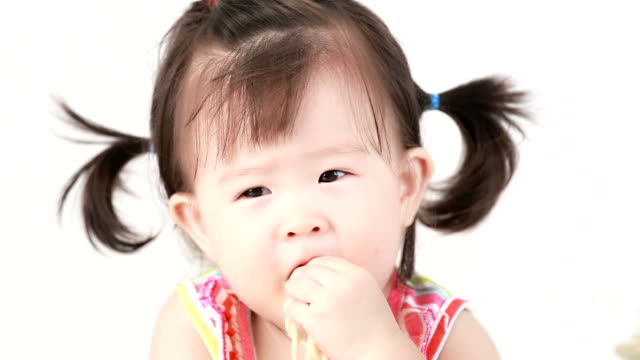 Little girl eatting spaghetti. video