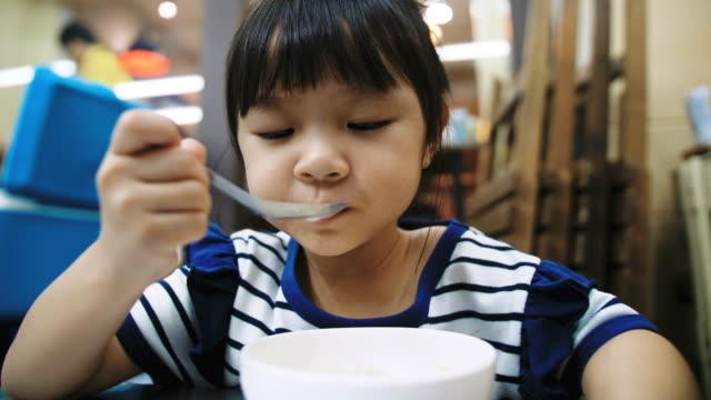 Little girl enjoy eating