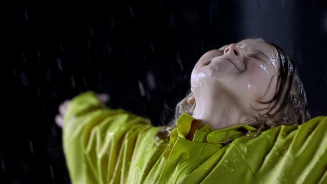 Little Girl Enjoying The Heavy Rain video