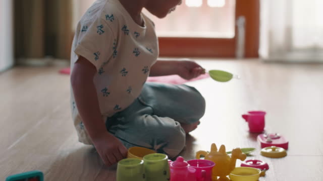 Little Girl Enjoyment With Toy On Floor video