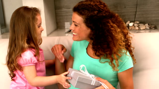 little girl giving a gift to her mother - mothers day stock videos & royalty-free footage