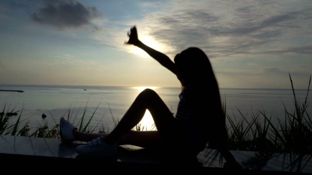 little girl greet the sunset on the sea, italy,lookout, calabria , summer,tropea - video di tropea video stock e b–roll