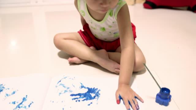 Little girl hand painting finger hand