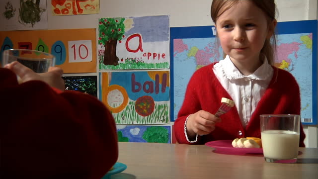 Little girl has healthy snack at school video