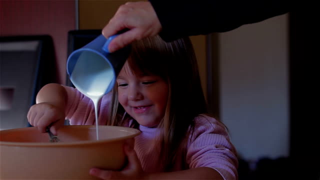 Little girl helping in the kitchen video