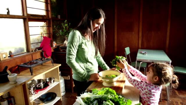 Little Girl helps Mom Making Healthy Food video