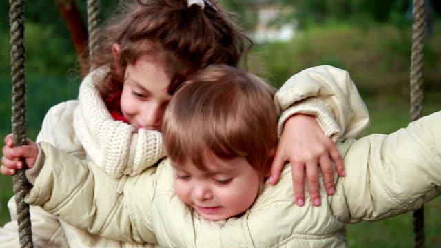 Little girl hugging her baby siter but she starts to cry