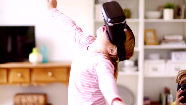 Little girl in a  Virtual Reality World video