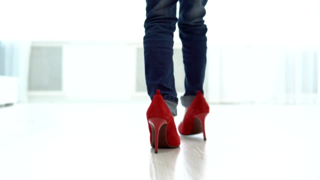 Little girl in mother's red shoes is walking around the house. Back view. Little girl in mother's red shoes is walking around the house. Back view. shoe stock videos & royalty-free footage