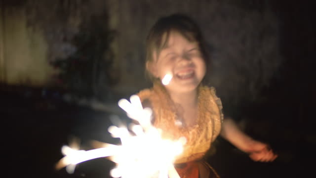 Little girl in thai dress with a sparkler in loi kratong festival video