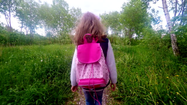 Little girl is going home from school. video
