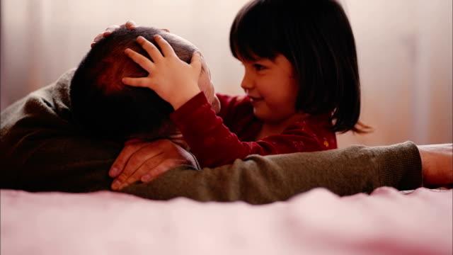 Little Girl is Hugging her Dad video
