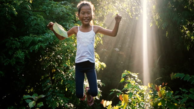 Little girl jumping in the jungles