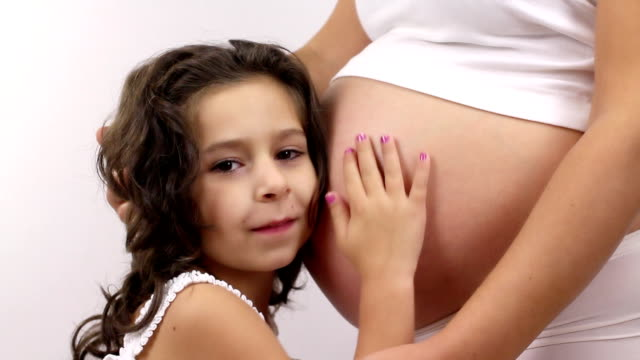 Little girl kiss her pregnant mother's belly video