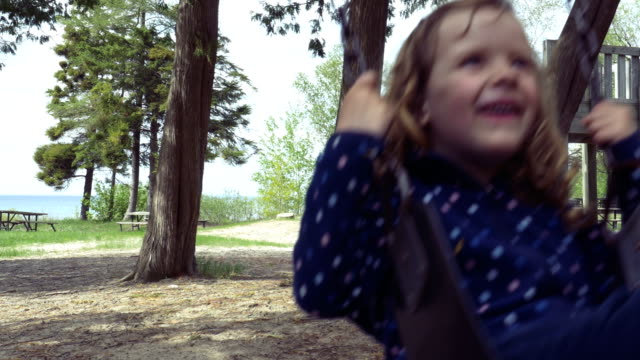 Little Girl Laughing on a Swing video