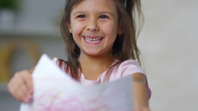 Little Girl Laughing when Showing Picture video