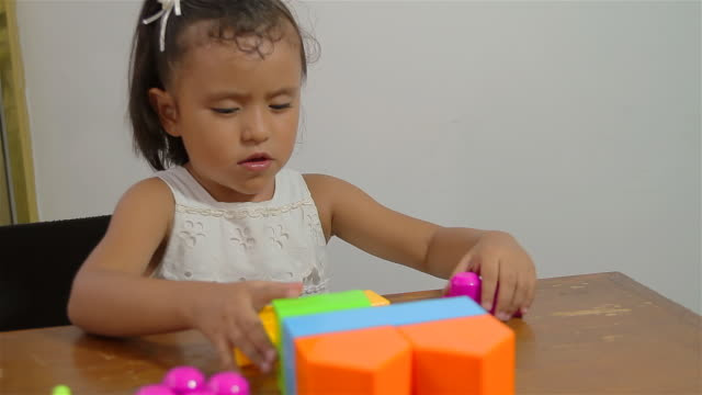 Little Girl Learning to Stack Blocks (HD) video