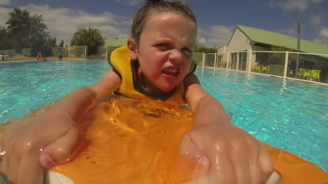 Little Girl Learning To Swim video