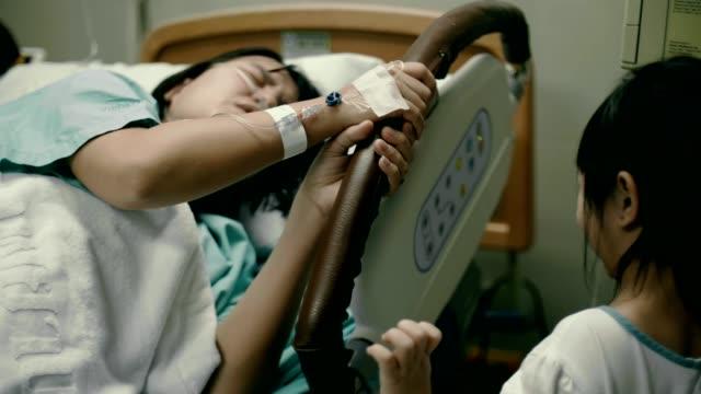 Little girl looking her mother patient