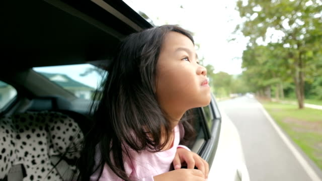 Little girl looking out from car video