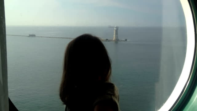 Little Girl Looking Out Of A Cruise ships Porthole video