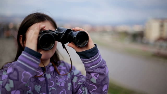 little girl looking through binoculars video