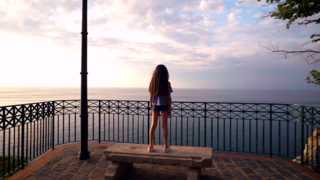 little girl looks at the the sunset on the sea, italy,lookout, calabria , summer,tropea - tropea video stock e b–roll