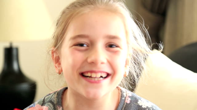 Little girl making a heart symbol video
