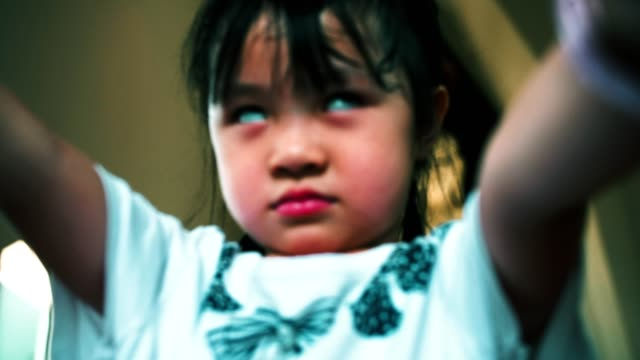 Little girl making scary face