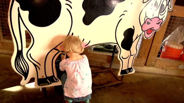 Little Girl Milking Cow video