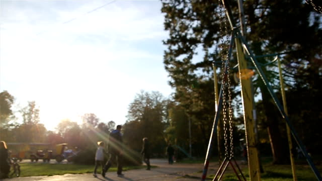 little girl on a swing, autumn - primary school stock videos and b-roll footage