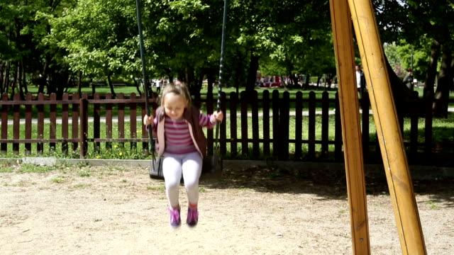 Little girl on a swing video