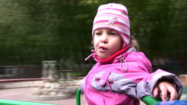 Little girl on carousel video