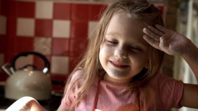 Little girl on kitchen video