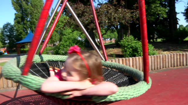 Little girl on swing in park video