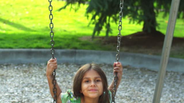 Little girl on swing video
