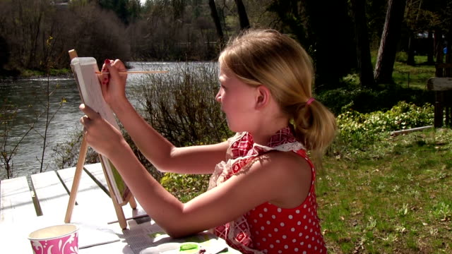 Little Girl painting by the river video