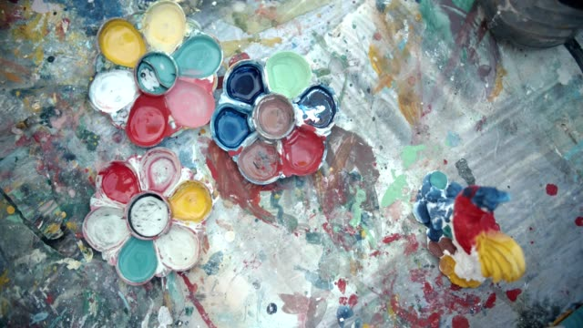 cu : little girl paints on paper use acrylic paint, brush and palette. - tavolozza video stock e b–roll