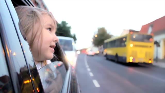 Little girl peeking through the window video
