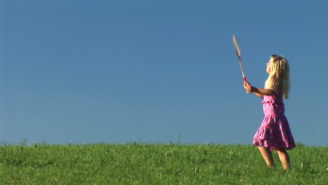 hd: little girl playing badminton - badminton stock videos & royalty-free footage