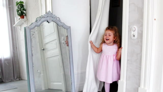 Little girl playing hide and seek video