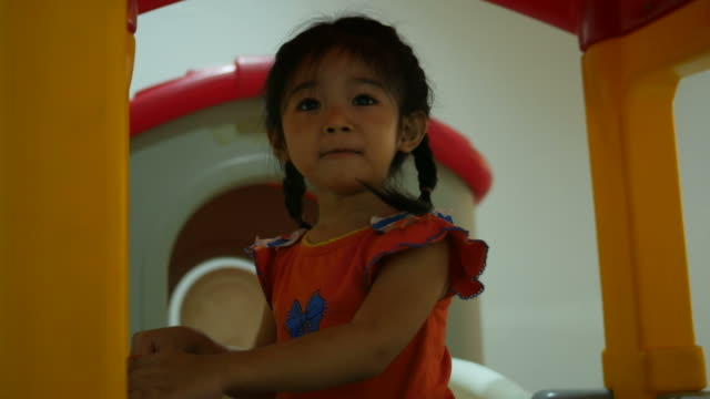 Little girl playing  in playground room video