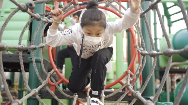 little girl playing in playground - vivere semplicemente video stock e b–roll