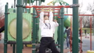 istock little girl playing in playground 1213469021