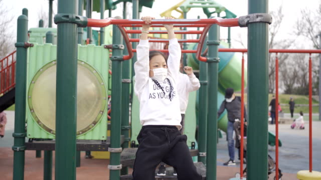 little girl playing in playground