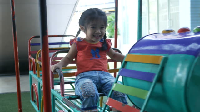 Little girl playing playground in park video