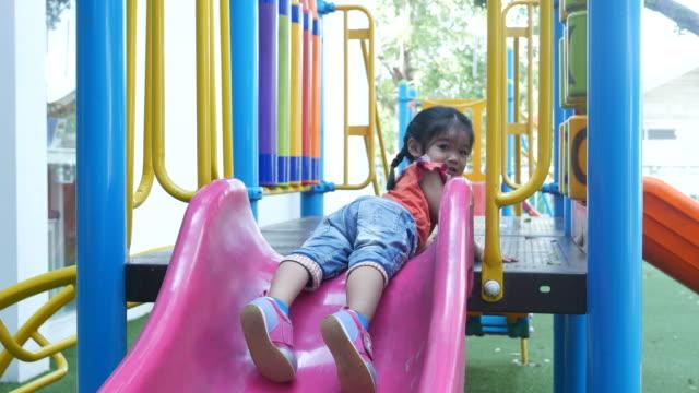 Little girl playing slider in park video