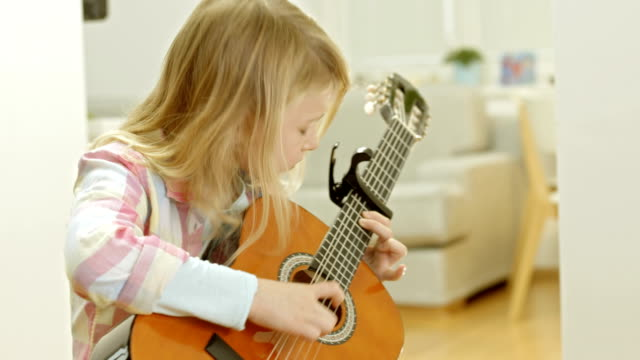 Little Girl Playing The Guitar video