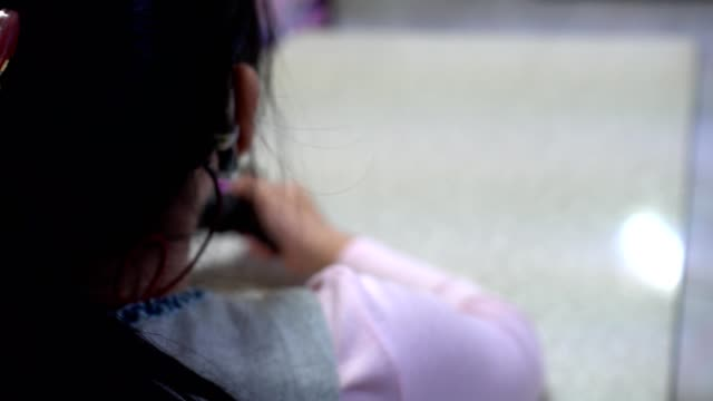 little girl playing video games with joystick. focus on head. - kids holding hands filmów i materiałów b-roll