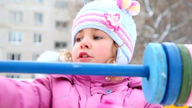 little girl playing with abacus in winter playground - abakus bildbanksvideor och videomaterial från bakom kulisserna